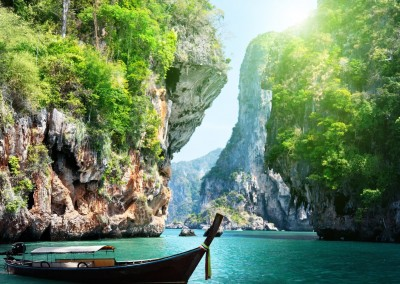 ESB Professional/Shutterstock.com // long boat and rocks on railay beach in Krabi, Thailand