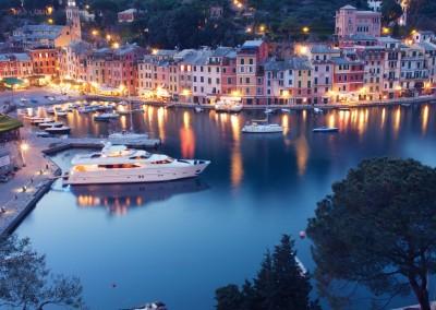 unknown 1861/Shutterstock.com - Colorful Portofino fishing village at dusk in Liguria, Italy